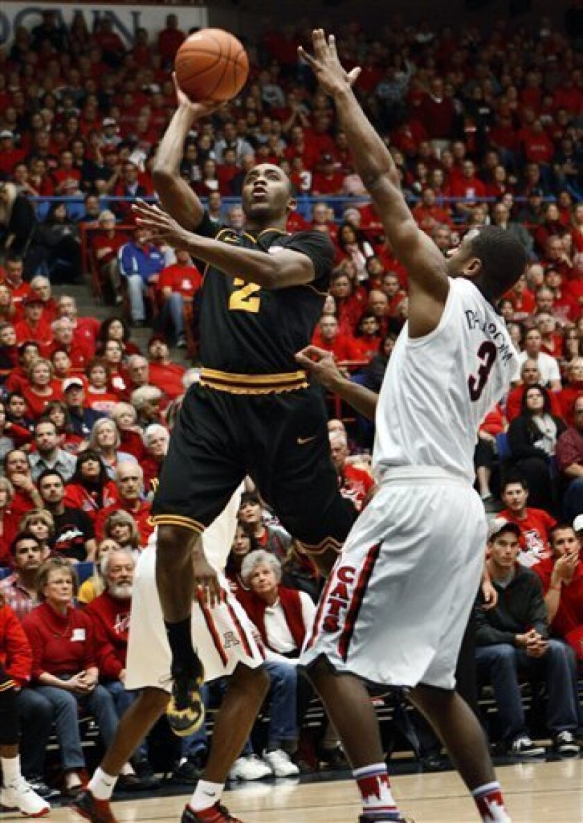 Arizona State's Chris Colvin (2) shoots over Arizona's Kevin Parrom (3) during the first half of an NCAA college basketball game at McKale Center in Tucson, Ariz., Saturday, March 9, 2013. (AP Photo/Wily Low)