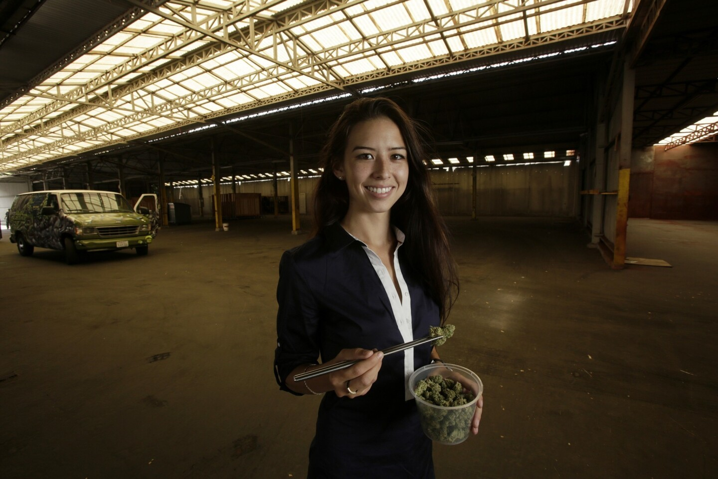 Paizley Bradbury, 22, executive director of Progressive Horizon Inc., holds a marijuana bud of strain called OG Kush in a large shed where the company is going to host the California Heritage Market on July 4-6 in Los Angeles.