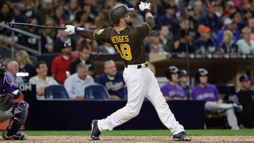 San Diego Padres' Austin Hedges watches his two-run home run during the fourth inning of the team's