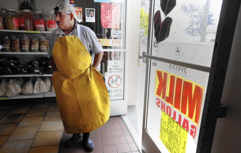 Miguel Sanchez, 43, works at Tortilleria San Marcos in Boyle Heights. He said an increase in the state's minimum wage to $15 an hour would give him some breathing room, but he doesn't plan to quit his second job.