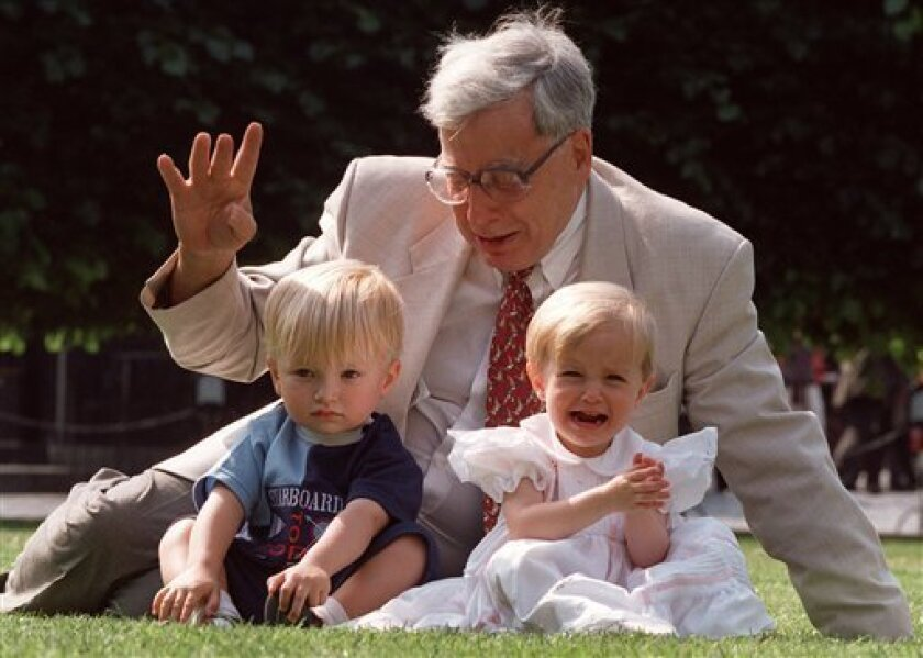 FILE- The British pioneer of IVF treatment, Professor Robert Edwards sits with two of his 'test-tube-babies', Sophie and Jack Emery who celebrate their second birthday in London in this file photo dated Monday July 20, 1998. The Nobel prize winner for medicine,  Edwards who was a pioneer of in-vitr