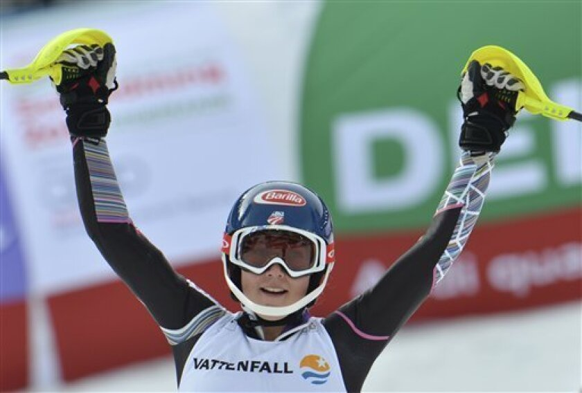 United States' Mikaela Shiffrin celebrates after the second run of the women's slalom at the Alpine skiing world championships in Schladming, Austria, Saturday, Feb. 16, 2013. Shiffrin won the gold medal. (AP Photo/Kerstin Joensson)
