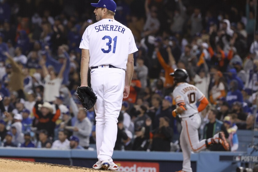 Los Angeles, CA - October 11: Los Angeles Dodgers starting pitcher Max Scherzer, left, looks back.