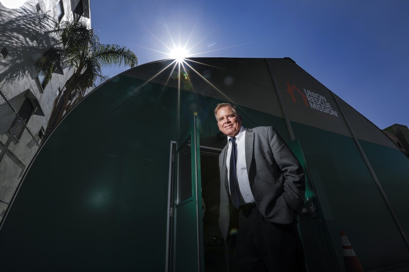 The Rev. Andy Bales, head of Union Rescue Mission, has set up a large tent that will be used as a shelter for homeless people.