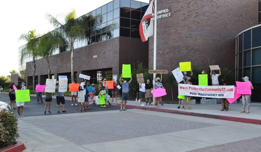 Community members gather outside the district office on Oct. 15.