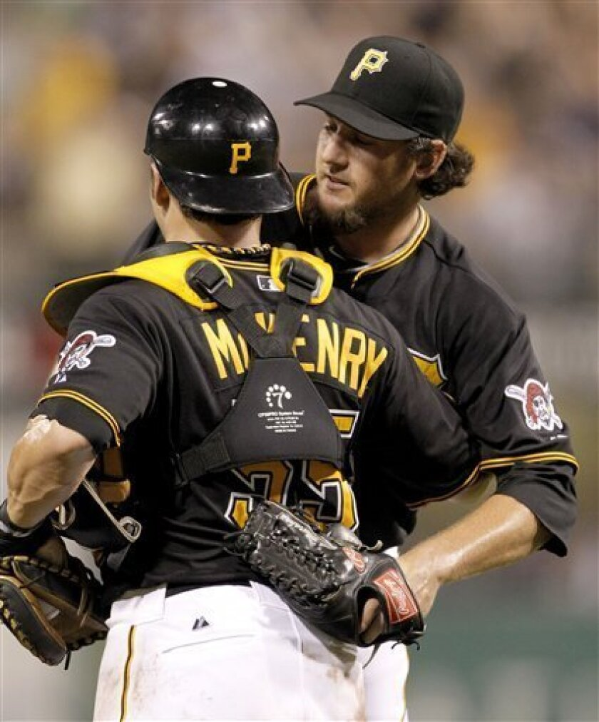 Pittsburgh Pirates relief pitcher Joel Hanrahan, right, is greeted by Pittsburgh Pirates catcher Michael McKenry after getting his 26th save of the season in the ninth inning of the baseball game against the Chicago Cubs, Friday, July 8, 2011 in Pittsburgh. The Pirates won 7-4. (AP Photo/Keith Srakocic)