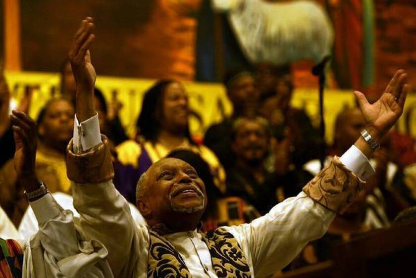 """The Rev. Cecil L. """"Chip"""" Murray presides over his last service at First AME church in 2004. Today, Murray's a rare guest at the church he built from 250 members to a congregation of 16,000."""