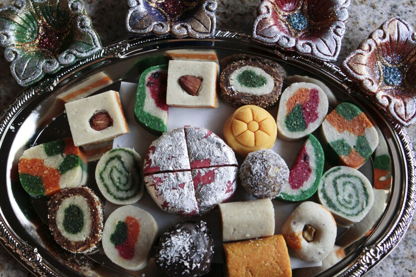 A variety of sweets are sold at Surati Farsan Mart restaurant in Artesia.