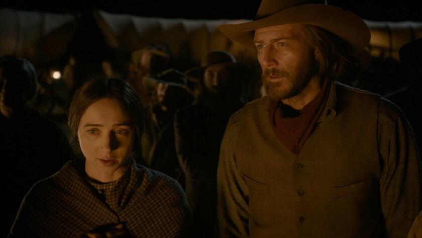 """Zoe Kazan and Bill Heck in the movie """"The Ballad of Buster Scruggs."""""""