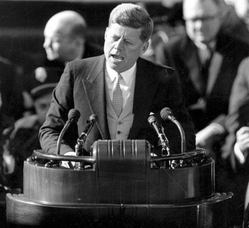 FILE - This Jan. 20, 1961 black and white file photo shows U.S. President John F. Kennedy delivering his inaugural address after taking the oath of office at Capitol Hill in Washington. (AP Photo/File)