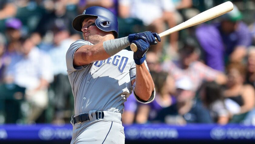 Padres outfielder Hunter Renfroe hits a sixth inning solo home run against the Colorado Rockies at Coors Field on Aug. 23, 2018 in Denver, Colorado.