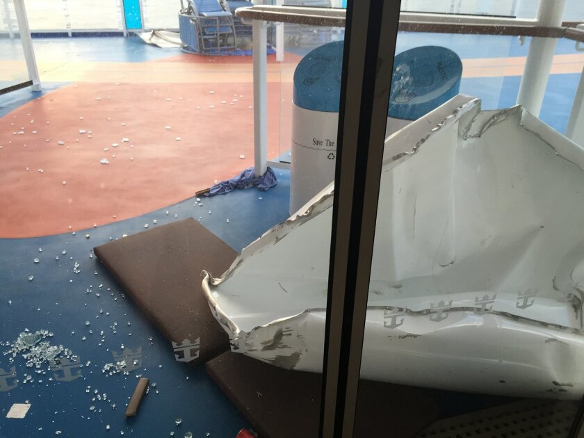 This image made available by Flavio Cadegiani shows damage to Royal Caribbean's ship Anthem of the Seas, Monday, Feb. 8, 2016. The ship ran into high winds and rough seas in the Atlantic Ocean on Sunday, forcing passengers into their cabins overnight. No injuries were reported and only minor damage