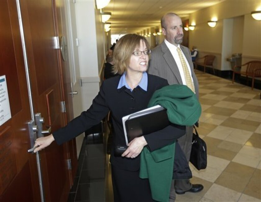 Assistant Utah Attorney's General Joni Jones, left, and David Wolf, right, arrive to court Tuesday, March 5, 2013, in Salt Lake City. A 3rd District Judge has given initial approval for the eventual creation of a board of trustees to take over homes and property belonging to a polygamous sect led by Warren Jeffs on the Utah-Arizona border. Judge Denise Lindberg approved the plan during a hearing Tuesday morning in Salt Lake City. Her approval is not a final decision, but rather permission to exp