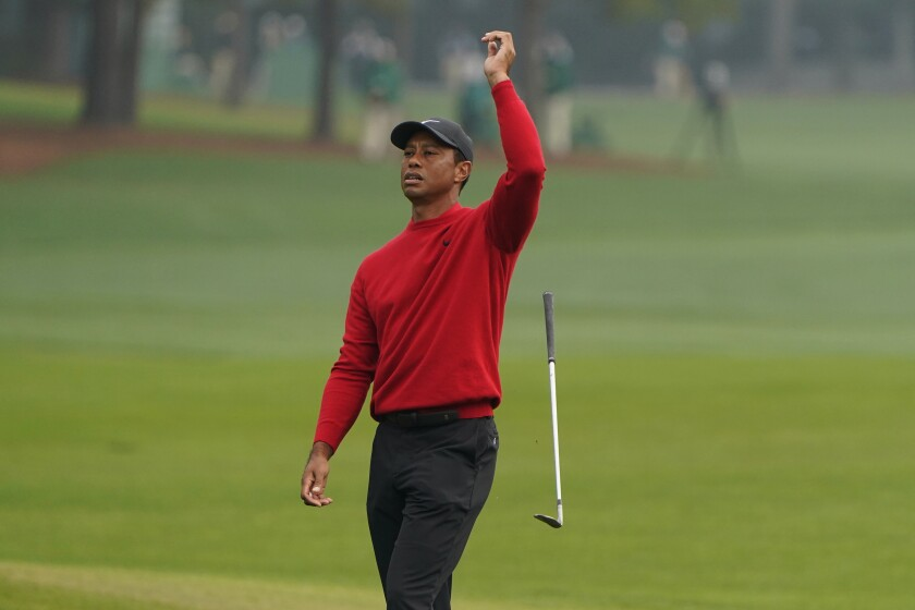 Tiger Woods reacts after a chip shot on the second hole during the final round of the Masters on Sunday.