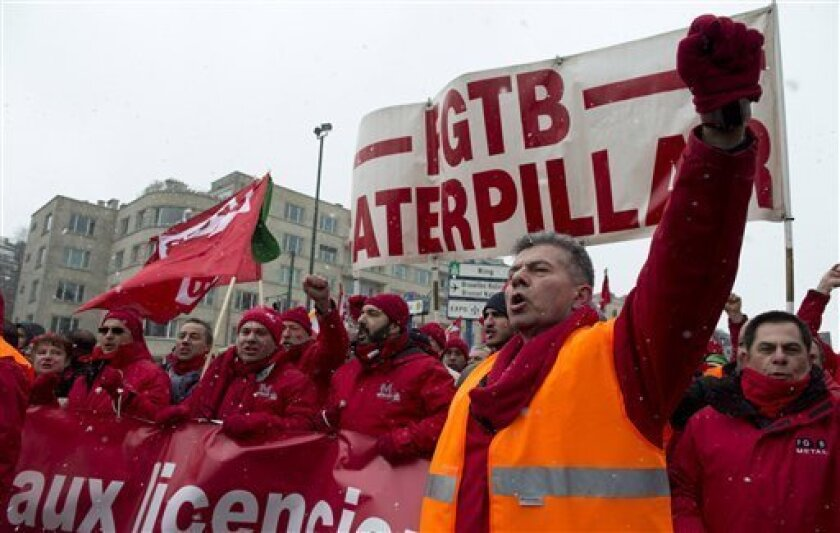 Union members march in solidarity for Caterpillar employees who have lost their jobs during a demonstration outside of an EU summit in Brussels on Thursday, March 14, 2013. Thousands of workers are converging on EU headquarters to demand an end to austerity measures in a demonstration coinciding with an EU summit aimed at boosting growth and reducing unemployment. Thursday's protest showed frustration of the European trade union movement claiming years of austerity imposed by EU leaders is only