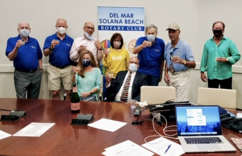 Del Mar-Solana Beach Rotary Club members making a toast at the recent Celebration of Giving.