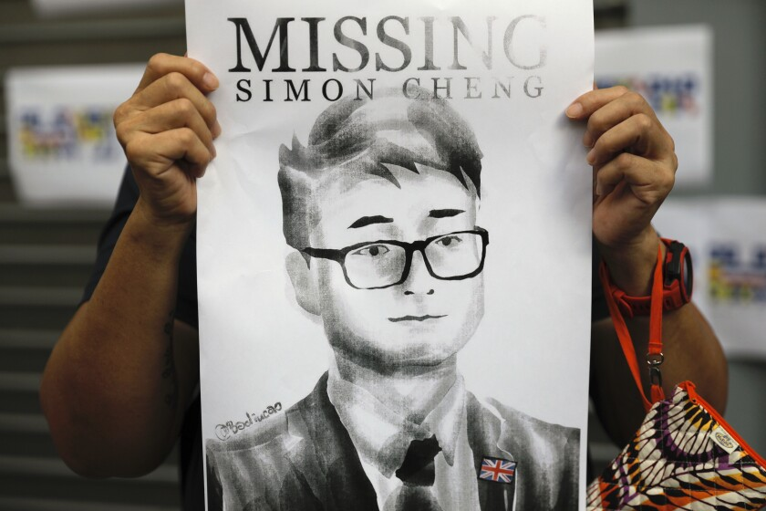A poster featuring Simon Cheng is displayed during a rally in support of him outside the British Consulate in Hong Kong  on Aug. 21, 2019.