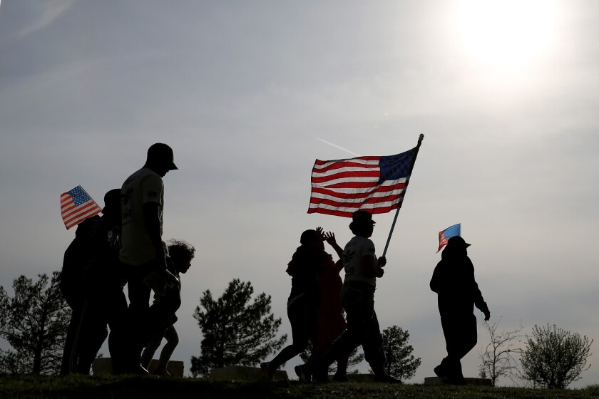 People walk in memory of those killed during Wednesday's shooting at Ft. Hood near Killeen, Texas.