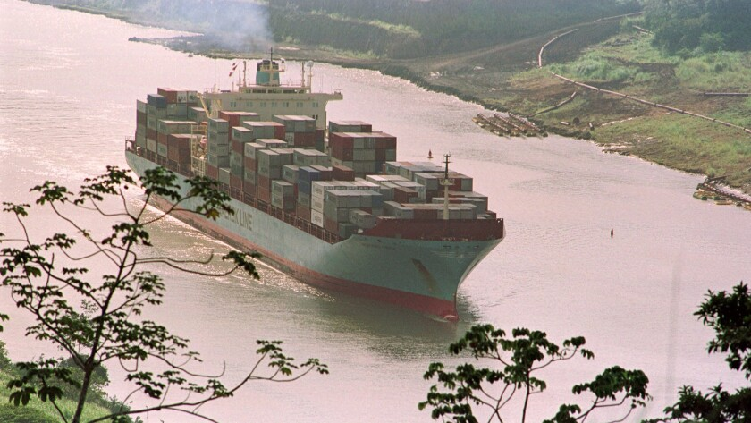 """A container ship transits the """"Gaillard Cut"""" section of the Panama Canal, 22 miles from Panama City, on Dec. 27, 1999."""