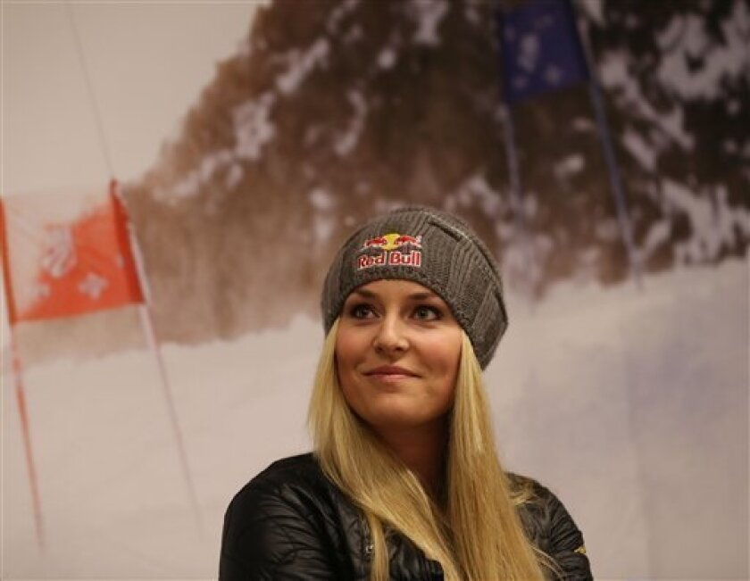 U.S. ski racer Lindsey Vonn watches during a press conference in view of the World Cup Alpine Skiing, in Schladming, Austria, Sunday, Feb. 3, 2013. With media attention on her personal life intensifying and some 400,000 fans expected, Lindsey Vonn will be surrounded by bodyguards at the Alpine skii