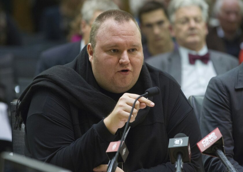 FILE - In this Wednesday, July 3, 2013 file photo, Internet entrepreneur Kim Dotcom speaks during the Intelligence and Security select committee hearing at Parliament in Wellington, New Zealand. Indicted Internet entrepreneur Kim Dotcom has defeated efforts to send him back to a New Zealand jail but says his long-running legal battle has left him broke. (AP Photo/New Zealand Herald, Mark Mitchell, File) NEW ZEALAND OUT, AUSTRALIA OUT