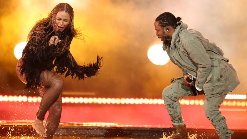 Beyonce and Kendrick Lamar perform on Sunday's show.