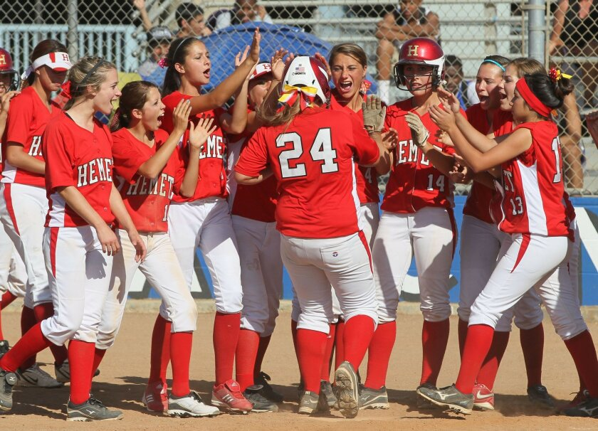 May 21, 2013, Lake Elsinore, California, USA_| Hemet's Cheyenne Gandara is congratulated at the plate after her two-run homerun over the left field fence in the Bulldogs' 4-0 win over Temescal Canyon.| Photo Credit: CHARLIE NEUMAN/U-T San Diego/ZUMA Press
