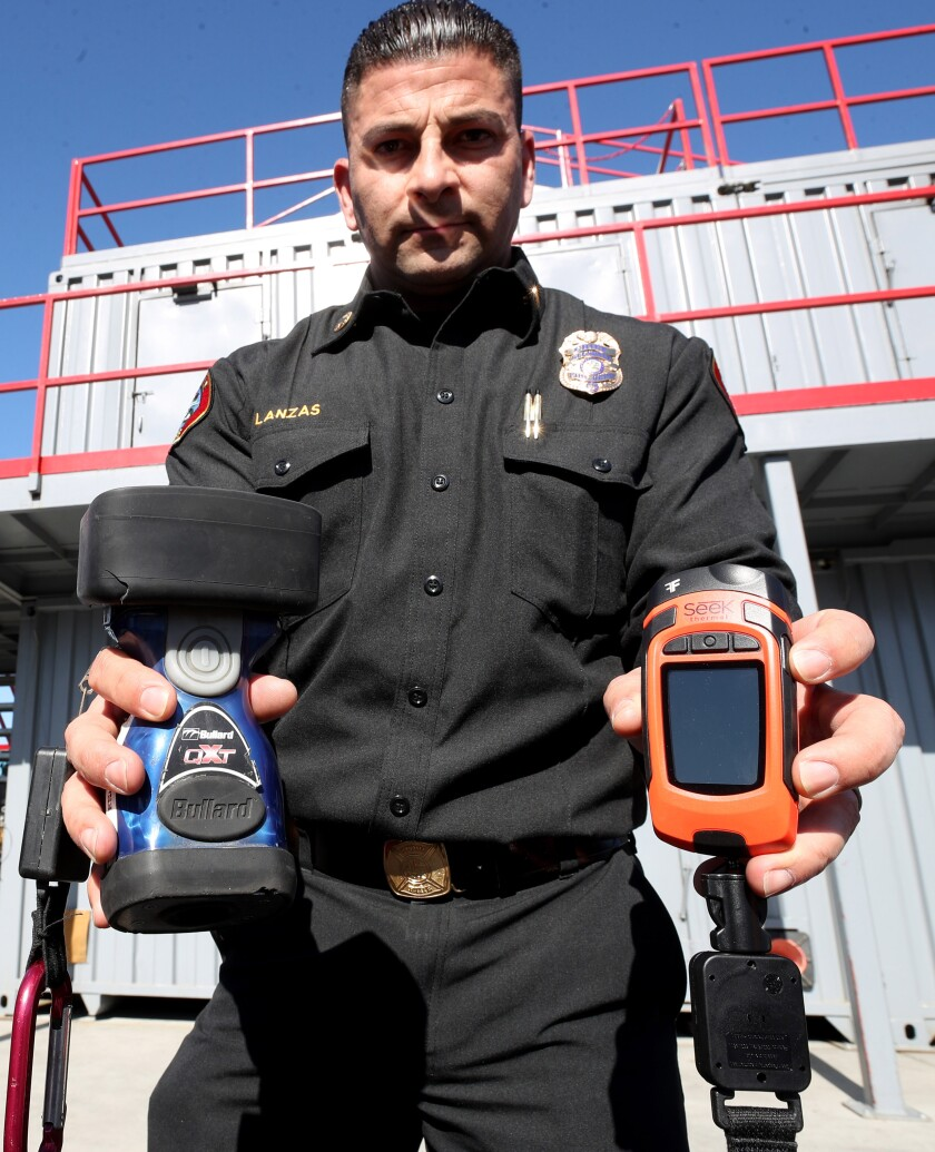 Glendale Fire Chief Silvio Lanzas holds one of the old thermal imaging cameras, left, that the department has been using compared to a newer one, right, that they will equip to all 50 on-duty firefighters beginning Thursday, Jan. 30.