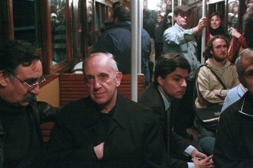 In this 2008 photo, Argentina's Cardinal Jorge Mario Bergoglio, second from left, travels on the subway in Buenos Aires, Argentina. Bergoglio, named pope on Wednesday, March 13, 2013, was known for taking the subway and mingling with the poor of Buenos Aires while archbishop. Bergoglio chose the na