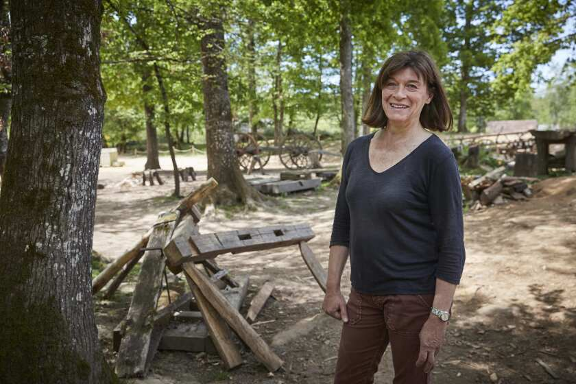 GUEDELON CASTLE, FRANCE - MAY 23: Maryline Martin, owner of Guedelon medieval castle project, photog