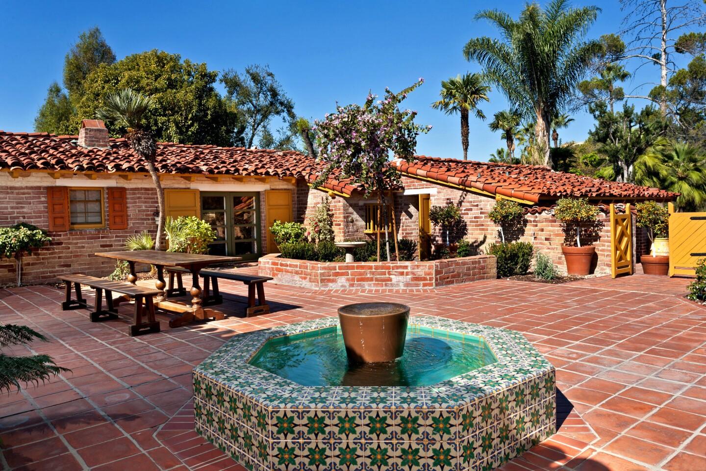 The hacienda-style home has a classic courtyard design.