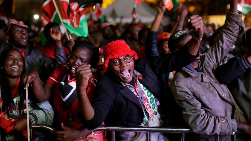 Supporters of President Uhuru Kenyatta erupt in cheers at the Kenya International Conference Center
