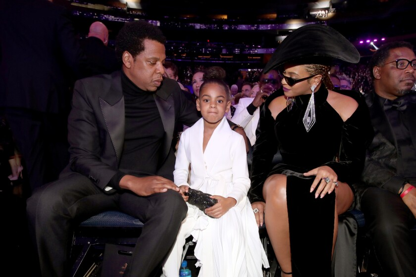 Jay-Z, left, Blue Ivy and Beyoncé attend the 60th Grammy Awards.