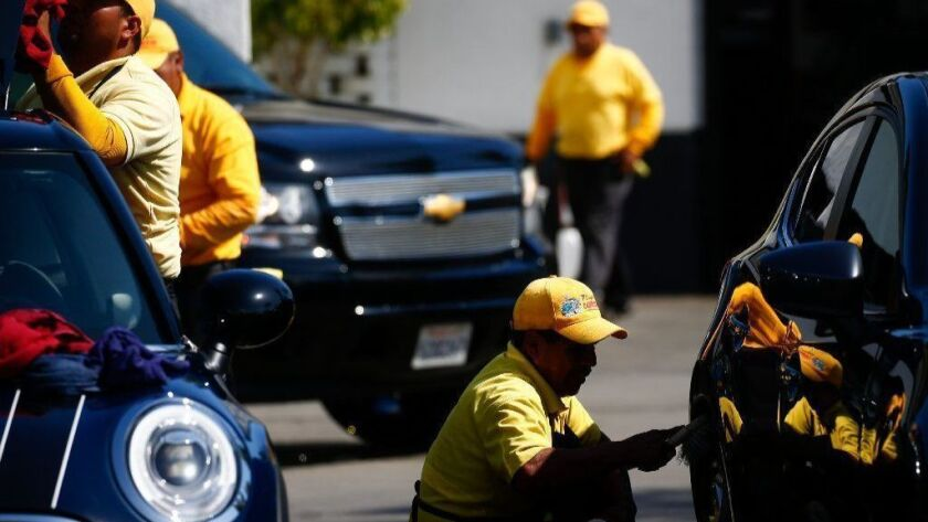Cars are washed and dried at the Playa Vista Car Wash in Culver City owned by auto dealership mogul Hooman Nissani.