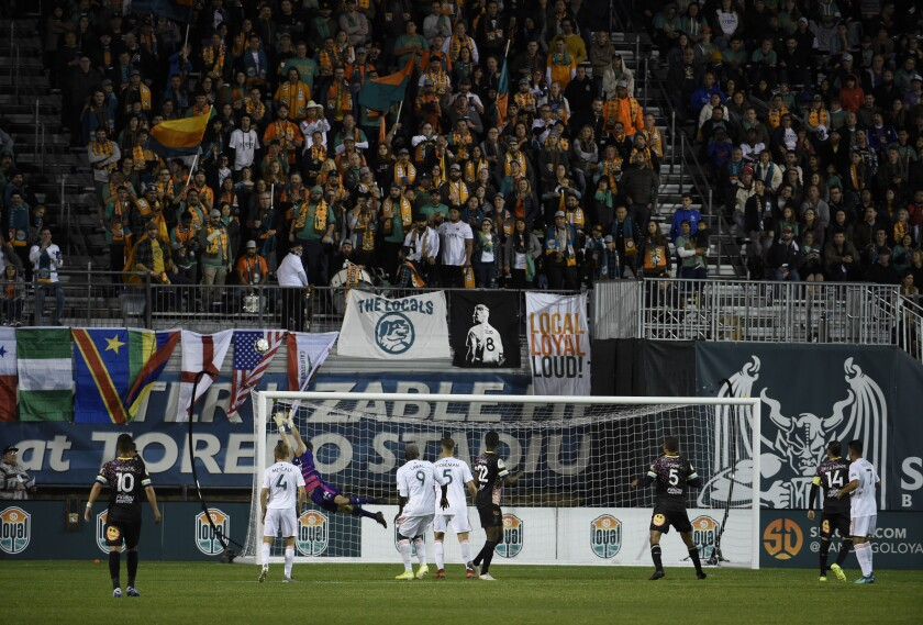 Fans look on as the San Diego Loyal takes a corner kick during the first half of their first game March 7.