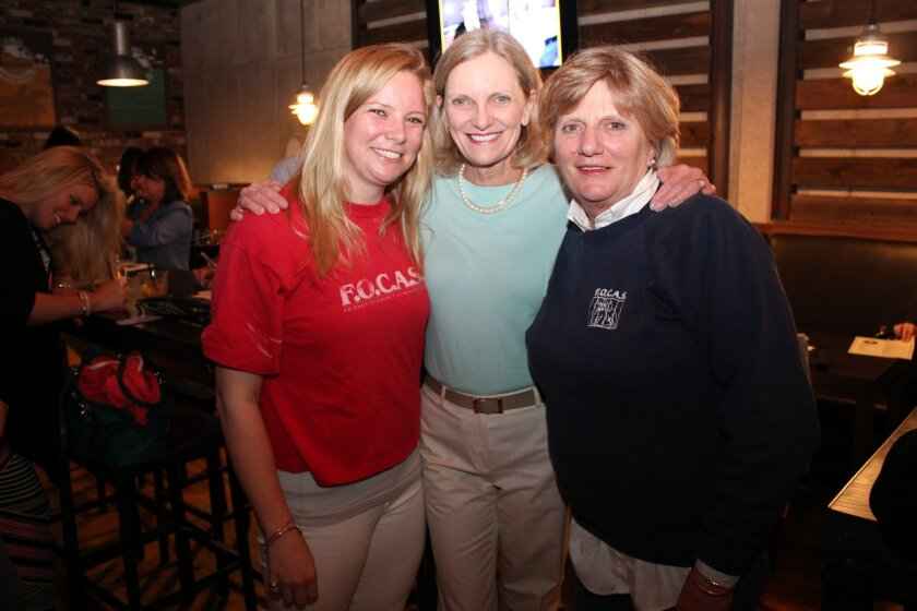 Emily LeBlanc, granddaughter of FOCAS co-founder Peggy Howell, with Peggy Howell's daughters, Susan Howell Mallory and Ruth Howell