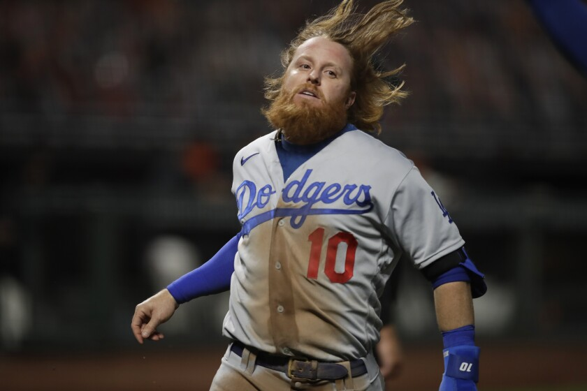 Dodgers' Justin Turner scores on a passed ball.
