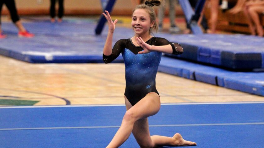 Tessa Anderson of West Hills on floor exercise during competition in the San Diego Section high scho