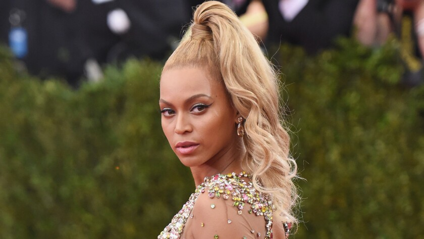 """Beyonce's hairstylist says the high ponytail she wore to the Metropolitan Museum of Art's Costume Institute Gala last week was a last-minute change. The event was themed """"China: Through the Looking Glass."""""""