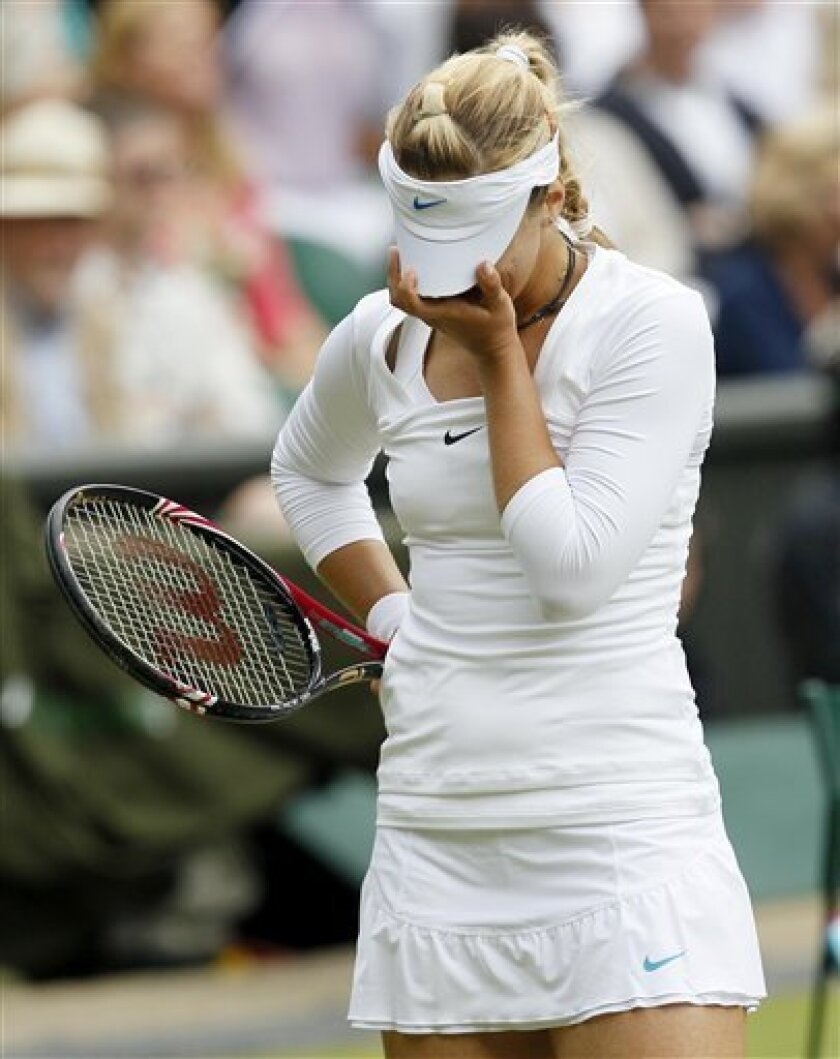 Germany's Sabine Lisicki reacts during the semifinal match against Russia's Maria Sharapova at the All England Lawn Tennis Championships at Wimbledon, Thursday, June 30, 2011. (AP Photo/Alastair Grant)