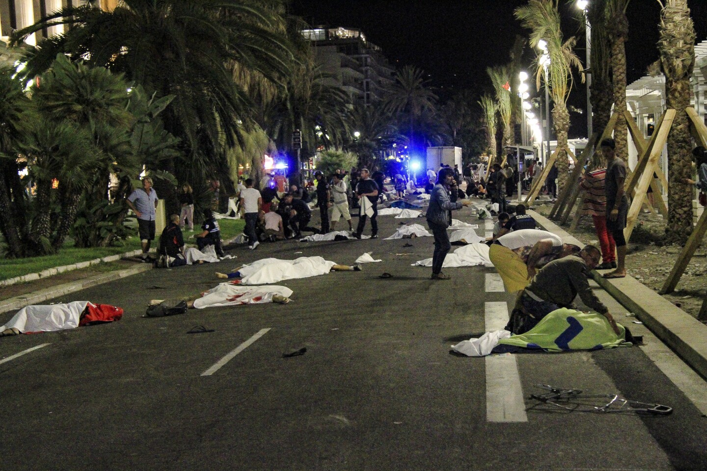 Bodies lay on the street after a truck drove through a crowded seaside promenade in Nice, France, during Bastille Day celebrations, leaving more than 80 dead and hundreds wounded.