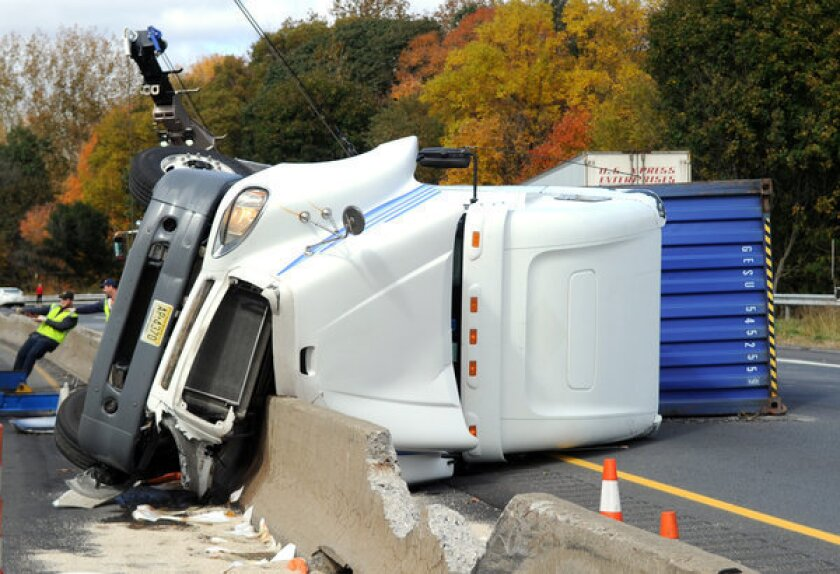 Crews clear the wreckage after a multi-vehicle crash near Stroudsburg, Pa.