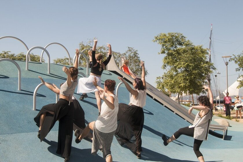 Dancers perform Liv Isaacs-Nollet's piece on a play-area dome.