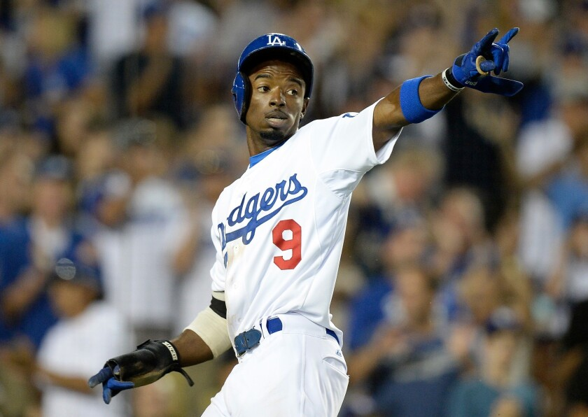 Dee Gordon reacts during a game against the Milwaukee Brewers at Dodger Stadium on Aug. 15.