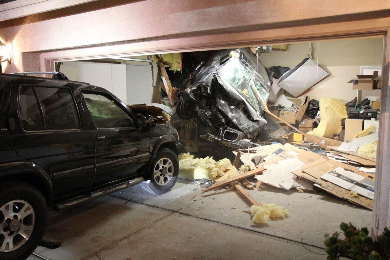 SUV slams through roof of Escondido home