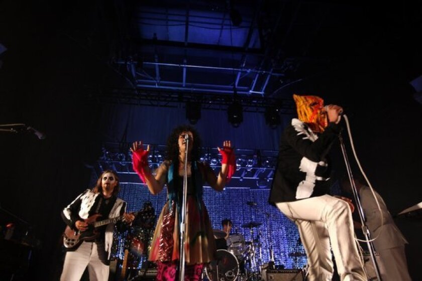 Arcade Fire masquerades as the Reflektors at the Hollywood Palladium in Hollywood on Halloween.