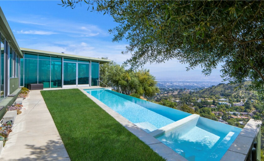 Designed by Hagy Belzberg, the low-slung home crawls across 1.5 acres overlooking L.A.