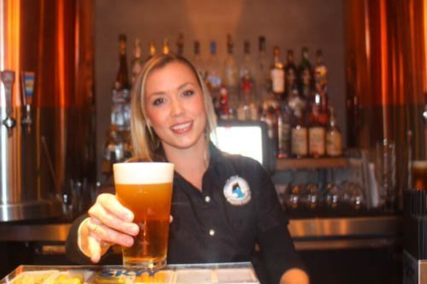 Desiree Patch offers one of more than 20 beers are on tap, some are brewed on site.