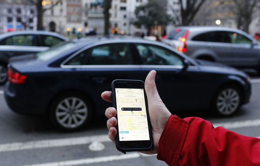 A Uber user hails a ride in Washington, D.C., in 2015.
