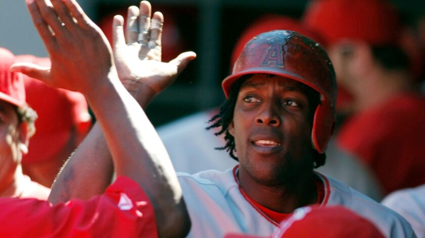 The Angels' Vladimir Guerrero is congratulated in the dugout after hitting a solo home run on a pitch from Seattle Mariners' Felix Hernandez during the fourth inning of their baseball game in Seattle Wednesday, Aug. 29, 2007.